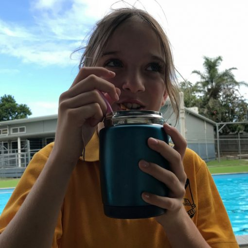 Girl eating from her personalised Cheeki insulated thermo jar